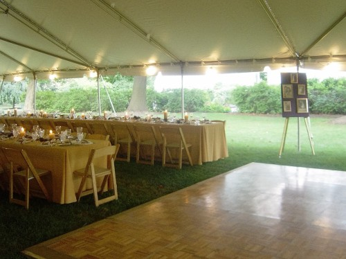 Tent Interior with photos on easel Curci Kramer Wedding